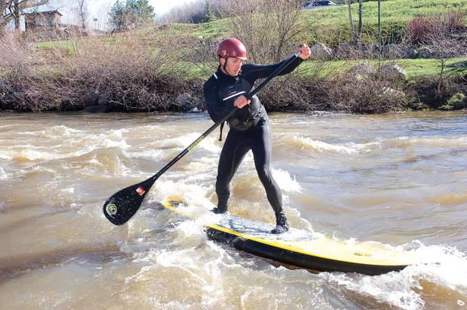 Cowabunga: Todd Givnish surfing it up on the Yampa.