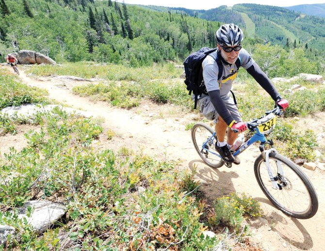 Cycle Town: John Dyas rides in the inaugural Ride 4 Yellow event in 2010 in Steamboat Springs.