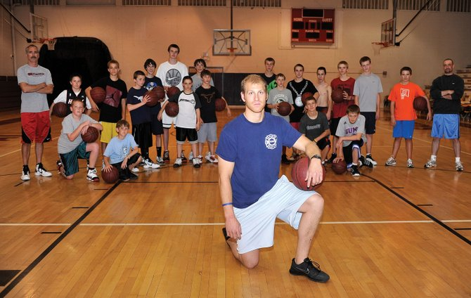 Devin Borvansky helps run a youth basketball program for fifth- through eighth-graders as a volunteer coach.