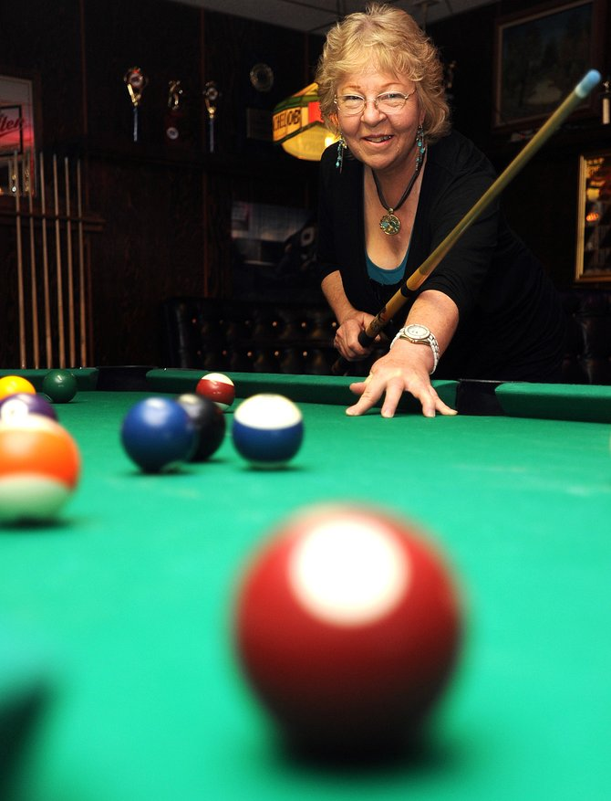 Joyce Hoekstra, 65, can rule the pool table, a skill she picked up in 20 years as one of the owners of Golden Cue Billiards, the only pool hall in Steamboat.