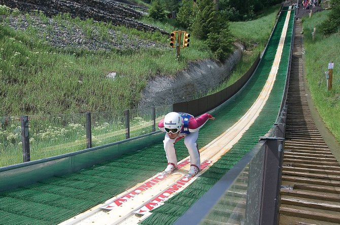 U.S. Nordic Combined Ski Team member Taylor Fletcher speeds down the in-run on Howelsen Hill's plastic-covered ski jump Thursday morning. Fletcher, who was raised in Steamboat Springs, is back in town with other members of the U.S. Ski Team for the Fourth of July Ski Jumping Extravaganza, which will take place Sunday and Monday at Howelsen Hill.