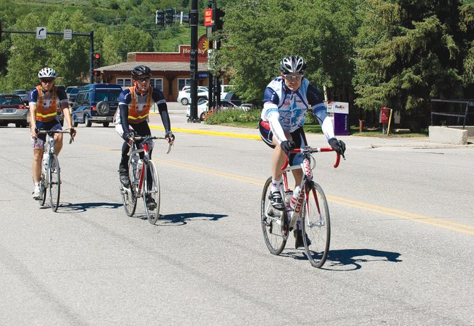 Cyclists Dustin Johnson, Colin Rose and Chris Anger roll into Steamboat Springs on Friday afternoon. The riders were participating in the Journey of Hope, a program of Push America, the national philanthropy of Pi Kappa Phi Fraternity, which raises funds and awareness for people with disabilities. The Journey of Hope team consists of men from Pi Kappa Phi chapters across the country. The team will cycle an average of 75 miles per day, beginning in San Francisco and Seattle and ending in Washington, D.C.