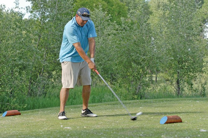 Nef Ramos, of Craig, drives from the 17th-hole tee box Sunday during the final day of the 44th annual Cottonwood Classic at the Yampa Valley Golf Course. Ramos said playing with the best competition in the state is a lot of fun and brings the best out of him.