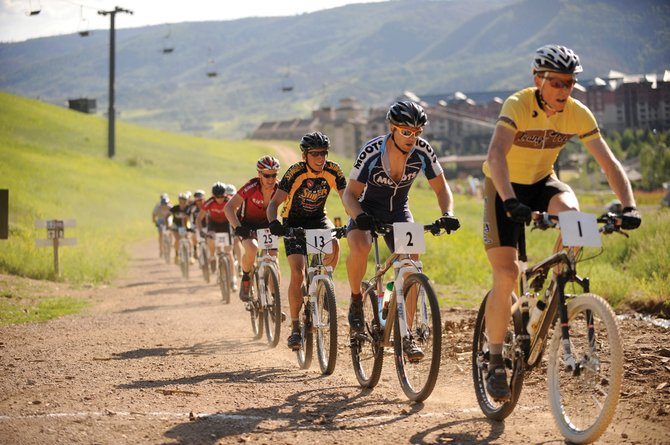"Men's pro riders begin their ascent up Steamboat Ski Area during the summer 2010 Town Challenge Mountain Bike Race Series Sunshine Loop event. This year's ""Unsunshine"" Loop starts at 5:30 p.m. Thursday."