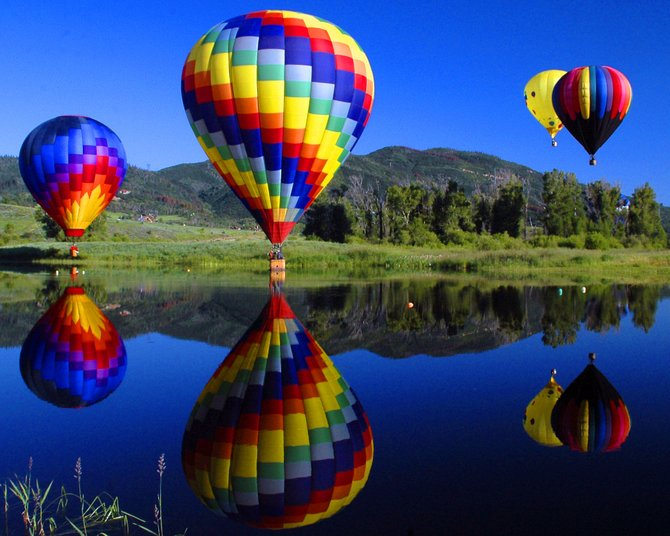 The annual Hot Air Balloon Rodeo and Art in the Park celebrations will hit Steamboat Springs on Saturday and Sunday. Art in the Park will offer work by about 140 artists, including Steamboat Pilot & Today photographer Joel Reichenberger, who will have a booth with framed photographs and photo compilations. This balloon rodeo photo will be among his work.