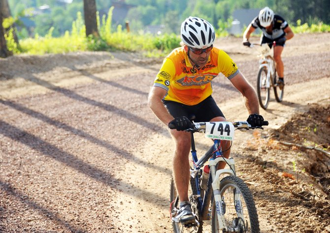 Scott Myller climbs Wednesday during a Town Challenge Mountain Bike Race Series event at Steamboat Ski Area. The event drew nearly 200 riders to attempt the course, which combined a grueling climb with a dangerous descent.