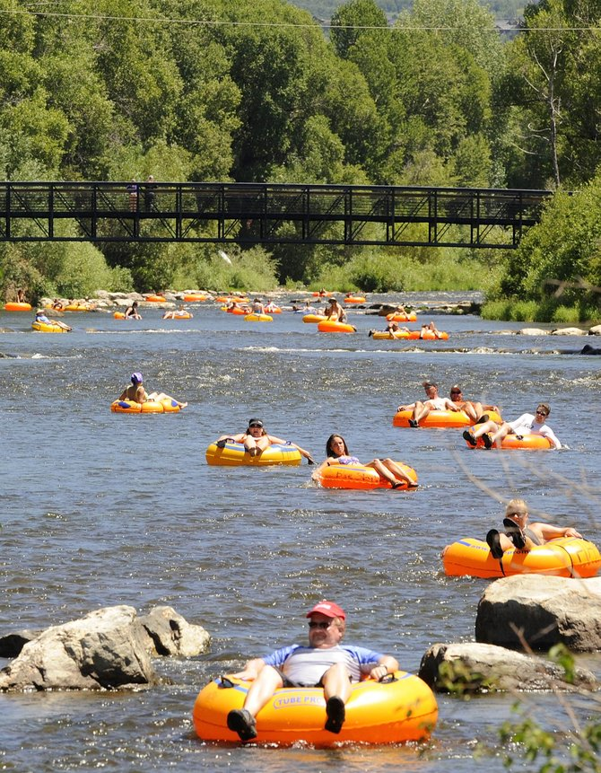 Tubers float down the Yampa River in July of last year. This year high water has delayed the start of the tubing season.