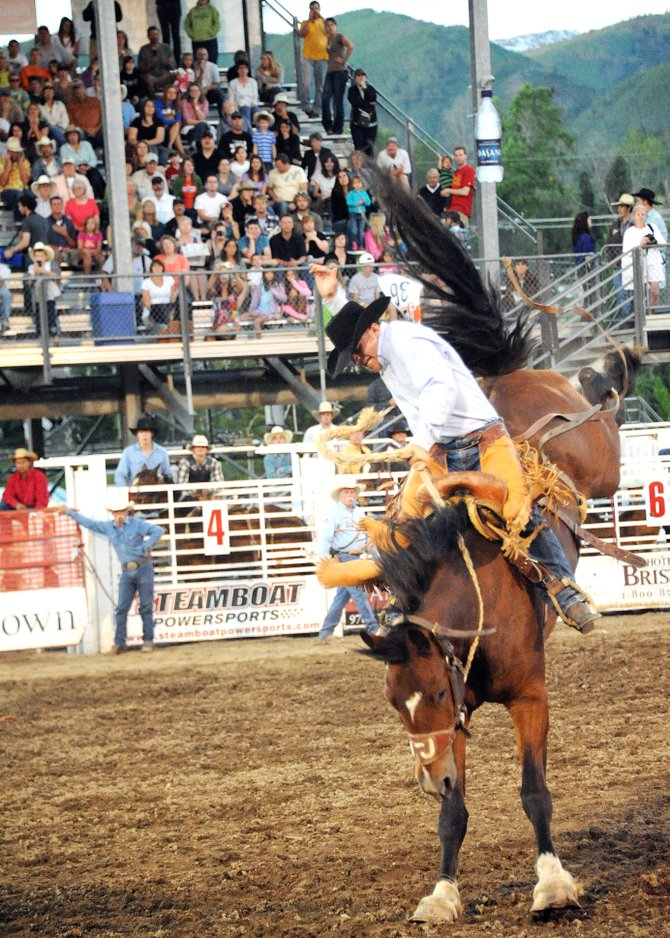 Cowboy Travis Darling, a former Steamboat Springs rider, clings to Gringo Honeymoon at a Steamboat Springs Pro Rodeo performance earlier this summer. Darling, 22, said his career is just getting started and has high hopes for this and the next few summers. He won the season-long saddle-bronc riding championship in Steamboat two years ago.