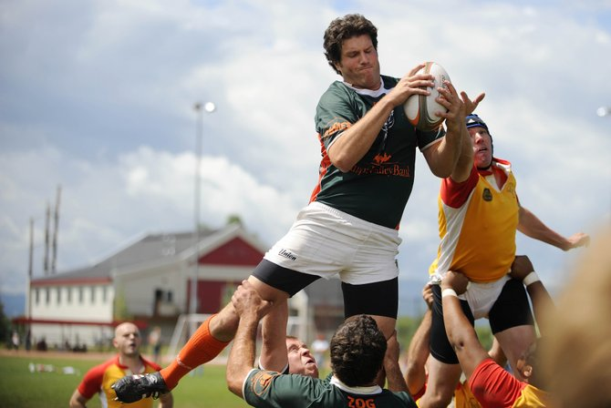 Steamboat Springs rugby player Matt Doubek grabs the ball during Saturday's 2011 Cow Pie Classic Rugby Tournament.