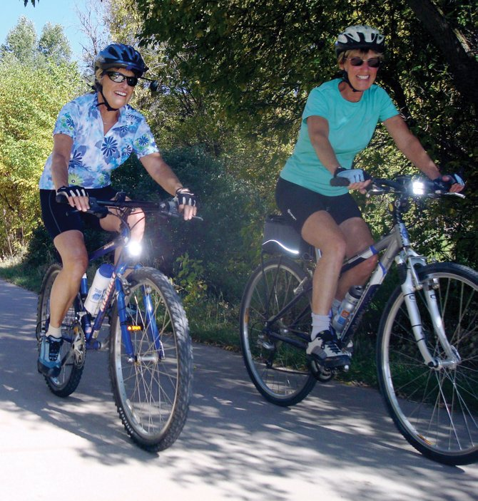 Linda Fairchild, left, and Kay Burch enjoy a ride on the Yampa River Core Trail. A strong biking community that includes bike clubs and advocacy groups helps make cycling in Northwest Colorado accessible to older adults.