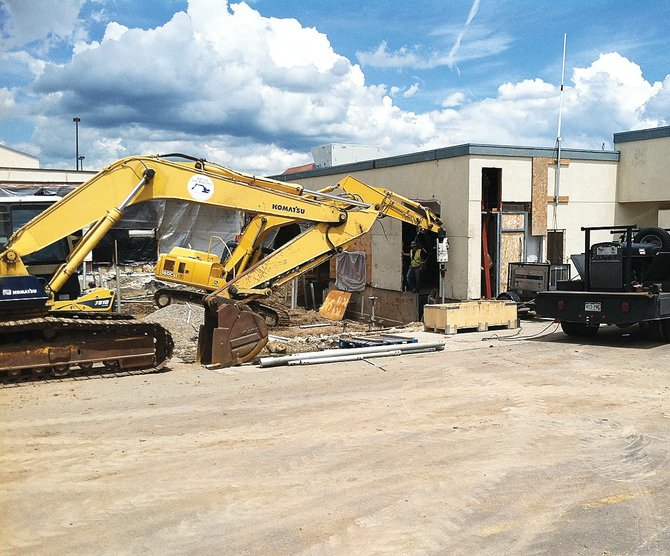 A Native Excavating backhoe drives helical piers for the foundation of an addition to the passenger terminal at Yampa Valley Regional Airport in Hayden on Monday.