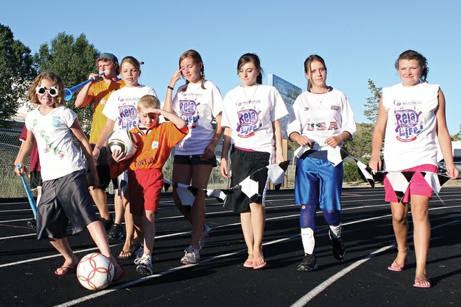 """Sammy the Cancer Hammers Too, the kids team,"" walks the opening lap of the 2010 Craig Relay for Life. This year's event, renamed the Yampa Valley Relay for Life, kicks off at 6 p.m. Friday at the Moffat County High School track, 900 Finley Lane."