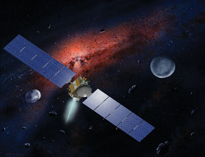 In this artist's conception, NASA's Dawn spacecraft is shown with its two targets nearby, asteroid Vesta, left, and dwarf planet Ceres, right. Dawn will visit Vesta this month before heading for a 2015 rendezvous with Ceres.