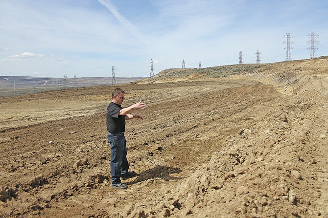 Gregg Kolbaba, president of Thunder Ridge Motor Sports Park, stands in April on the stock car track, which was under construction at the time. The track will host its first stock car race at 7:30 p.m. Saturday after inclement weather pushed back earlier dates.