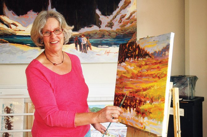 Plein air painter Joan Hoffmann demonstrates her work in a painting from Rabbit Ears Pass that she began Tuesday morning. Hoffmann has about 60 pieces on display this month at the Depot Art Center.