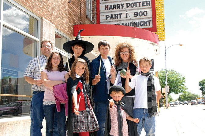 "The Hebert family, of Craig, poses Thursday morning outside West Theatre on Victory Way. Dave Hebert began waiting outside the theater at 5 a.m. to be the first in line for the midnight premiere of ""Harry Potter and the Deathly Hallows: Part 2."" Shown in the back row, from left, are Dave, Patty, Spencer, and Rachel; in the front row are Sabrina, Heather, Mathew and Samuel."