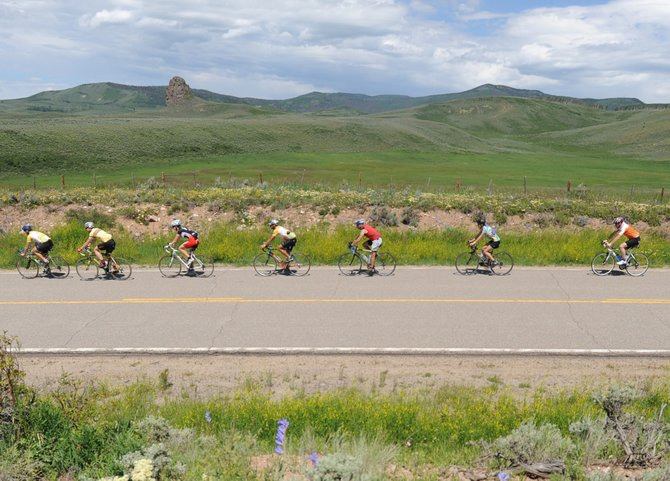 Riders fly along the course of the 110-mile ride of the Tour de Steamboat near Toponas on Saturday. The event attracted more than 600 people to its three rides, including 350 to the long 110-mile version. More than $65,000 was raised to support the Sunshine Kids foundation, all of which will go to allowing children in the cancer-fighting program to visit Steamboat Springs this winter.