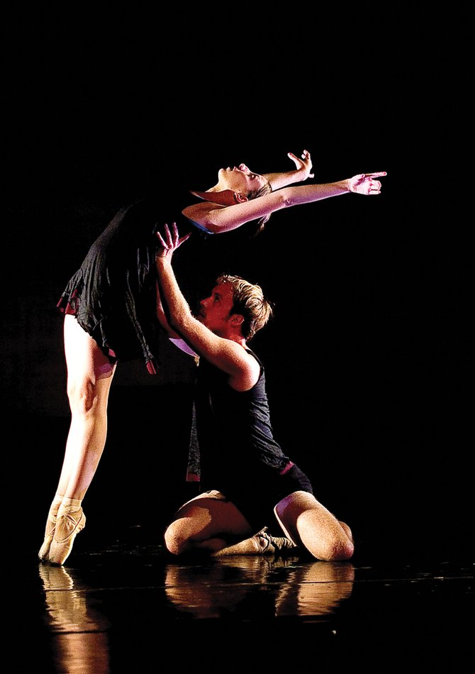 "Dancers Bryony McCullough and Christopher LaFleche perform ""Slow Falling,"" a dance choreographed by Rick McCullough that will premiere at this weekend's Evening of Dance."