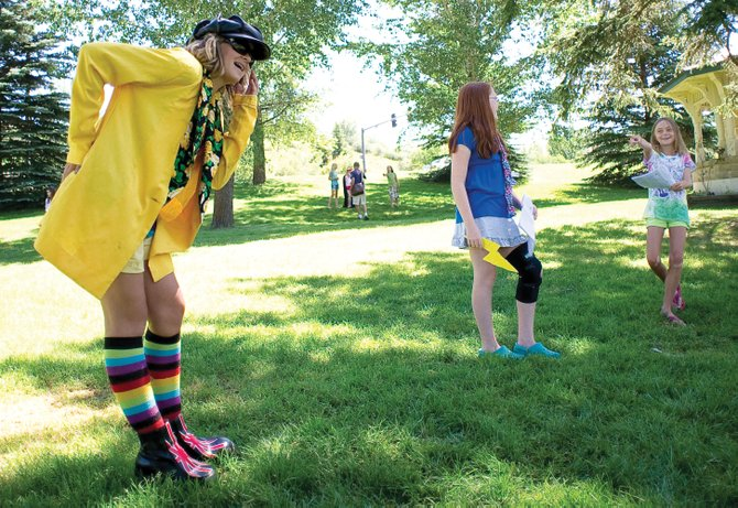 Young actors Leah Rowse, Miriah Walker and Alison Famulare perform a scene from an original play Wednesday in West Lincoln Park during an acting workshop that is part of the Kaleidoscope summer camp program