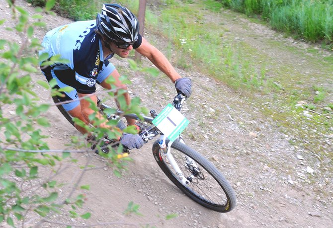 Brad Bingham races toward the base of Howelsen Hill on Wednesday during the Town Challenge Mountain Bike Race Series in Steamboat Springs. Bingham won the men's pro division, and Kelly Boniface was tops among the women in the Beetlekill Cross-Country.