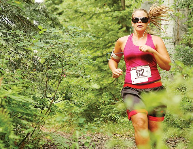 Katie Smith runs along the rough trail of the Spring Creek Memorial 9-mile race in 2009. The Steamboat Springs Running Series event returns Saturday.