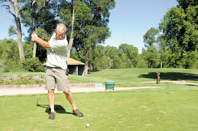 Jerry Hoberg, 57, takes a practice swing Thursday on the 16th hole at Yampa Valley Golf Course. Hoberg said he used his Cleveland Halo 2i fairway wood to sink his first hole-in-one June 23 on the same hole.