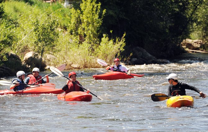 Marty Smith, right, leads a beginners kayak lesson from Mountain Sport Kayak School down the Yampa River on Friday in Steamboat Springs.