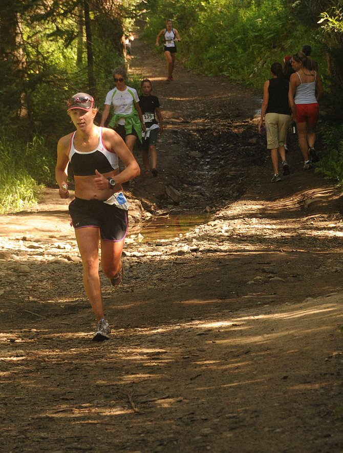 Anna Bergman runs Saturday on Spring Creek Trail in the 9-mile race of the Spring Creek Memorial in Steamboat Springs. Bergman, of Iowa, finished second in the race, which drew more than 180 competitors.