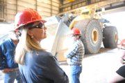 State Senator Jean White, R-Hayden, views heavy equipment Wednesday during a tour of Trapper Mine, Inc. The tour was part of a busy agenda for White, two representatives of the Colorado Department of Labor and Employment, and community leaders. The group also toured Tri-State Generation & Transmission and participated in an education session to discuss the economic impacts of regional energy industries and the workforce. In the background is the largest front loader in the world – a $3 million dollar behemoth made by LeTourneau.