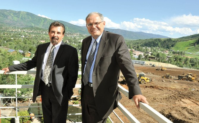 Colorado Mountain College Alpine Campus CEO Peter Perhac, left, and CMC President Stan Jensen stand Thursday in front of the construction site of the Alpine Campus' new academic and administrative building, which broke ground last month. CMC has launched a fundraising campaign for the building.