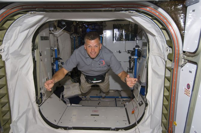 "Astronaut Steve Swanson, STS-119 mission specialist, floats through a hatch March 18, 2009, on the international space station while shuttle Discovery remains docked with the station. Swanson called Thursday ""a sad day for the space program"" after Atlantis landed, signaling the end of the 30-year space shuttle program."