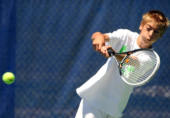 Nick Mathews eyes a return on Sunday while playing in the Steamboat Tennis Association Summer Championships in Steamboat Springs.