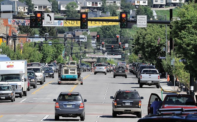 Red lights and traffic line Lincoln Avenue in Steamboat Springs on Monday afternoon. Colorado Department of Transportation crews will run fiber-optic cable below Lincoln Avenue on Tuesday.