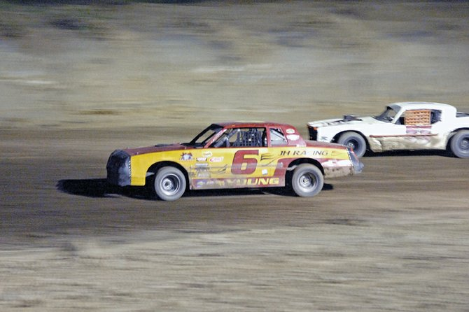 John Young, of Montrose, battles for the lead Saturday at Thunder Ridge Motor Sports Park, south of Craig. The event was the new racetrack's inaugural run for stock cars. Young said with time and support, he's confident Thunder Ridge will succeed.