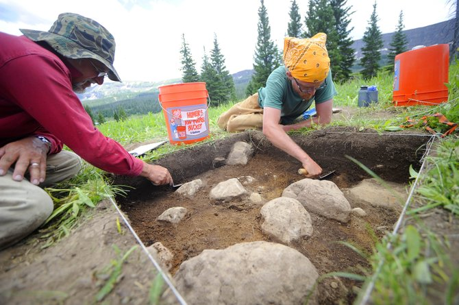 U.S. Forest Service workers Mike Stites, right, and Andrew Dutt excavate a section of land on the edge of the Flat Tops Wilderness Area. Artifacts were found during a six-day dig that are suspected of being between 8,000 and 9,000 years old.