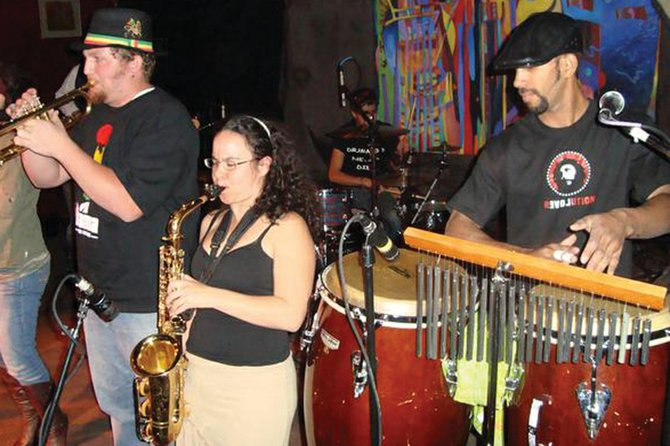 Craig native Randy Runyan, left, performs with the Latin reggae band Mono Verde during a show in Denver. Runyan has played the trumpet for the 10-piece group since 2008. Mono Verde will perform in Craig at 8 p.m. Friday at The O.P. Sports Bar & Grill, 534 E. Victory Way.