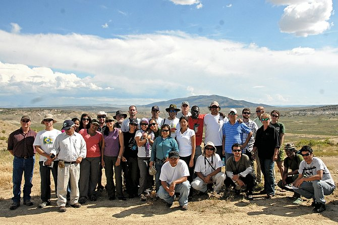 Land managers from Latin America pose with officials from the Bureau of Land Management's Little Snake Field Office on Wednesday at Sand Wash Basin. Cross Mountain, one of seven wilderness areas the Little Snake Field Office manages, is shown in the background.