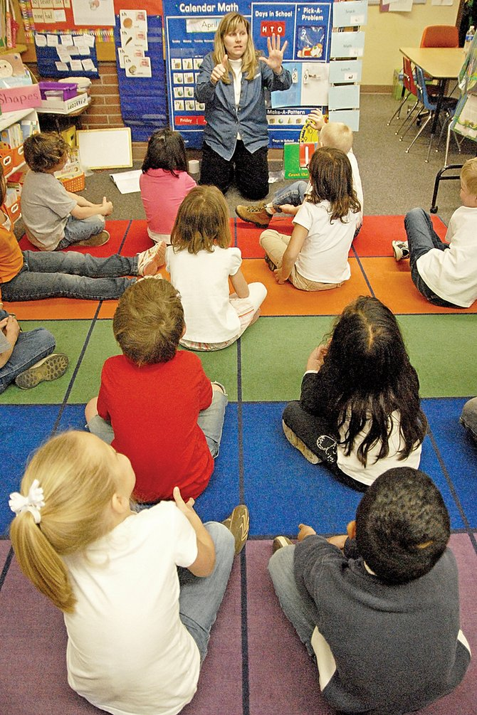 Last year, the Moffat County School District became one of 119 plaintiffs in Lobato v. Colorado, a court case that challenges the constitutionality of the state's system for funding public education. The trial begins Monday in Denver District Court and is expected to last five weeks. Above, kindergarten students in Melany Neton's Sunset Elementary School classroom learn math skills in late April.