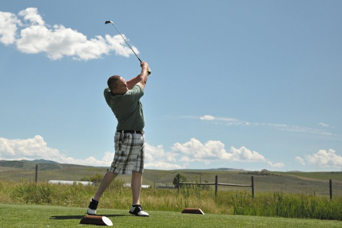 Aaron Knack tees off on the sixth hole Friday during the fourth annual Bear River Young Life Golf Tournament at Yampa Valley Golf Course. The tournament brought in 18 teams and raised about $6,000 to help send Young Life members to summer camps.