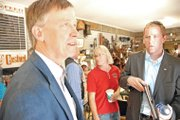 Gov. John Hickenlooper discusses the job market Friday with a Hayden resident at Yampa Valley Feeds. The governor was in Northwest Colorado to discuss his economic development strategy for the state.