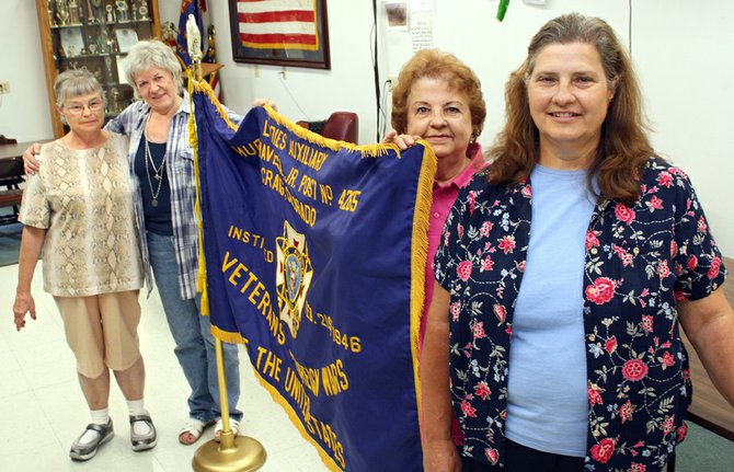 From left, Mary Walters, Sandy Mansfield, Virginia Cromer and Jeannie Wixson hold up the flag for the Ladies Auxiliary of the Veterans of Foreign Wars Post 4265. The group is in its 65th year in Craig and will be hosting a free lunch for seniors on Aug. 12 at the covered picnic area of the Moffat County Fairgrounds.