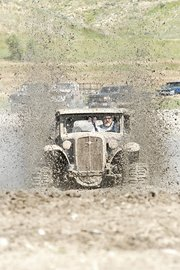 Tom Derr, of Rawlins, Wyo., tears through the mud Saturday in his 1931 Chevy 5-Window Coupe. Derr won first place in the pro-stock class during the 2011 Moffat County Mud Runs at Wyman Museum. The event featured 55 drivers competing in nine classes. About 200 spectators attended.
