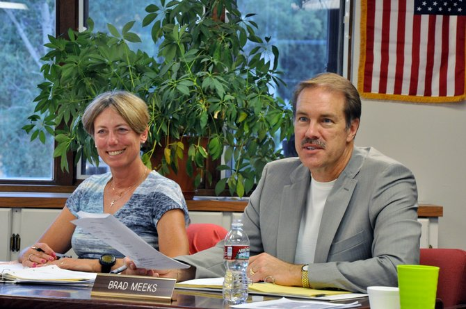 Steamboat Springs School Board Superintendent Brad Meeks with School Board President Robin Crossan attends Meeks' first meeting Tuesday.