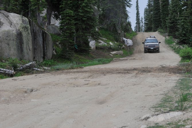 A jeep makes its way along one of the better parts of the Buffalo Pass road Wednesday afternoon. Planned work on the culvert could close the road by Aug. 15.