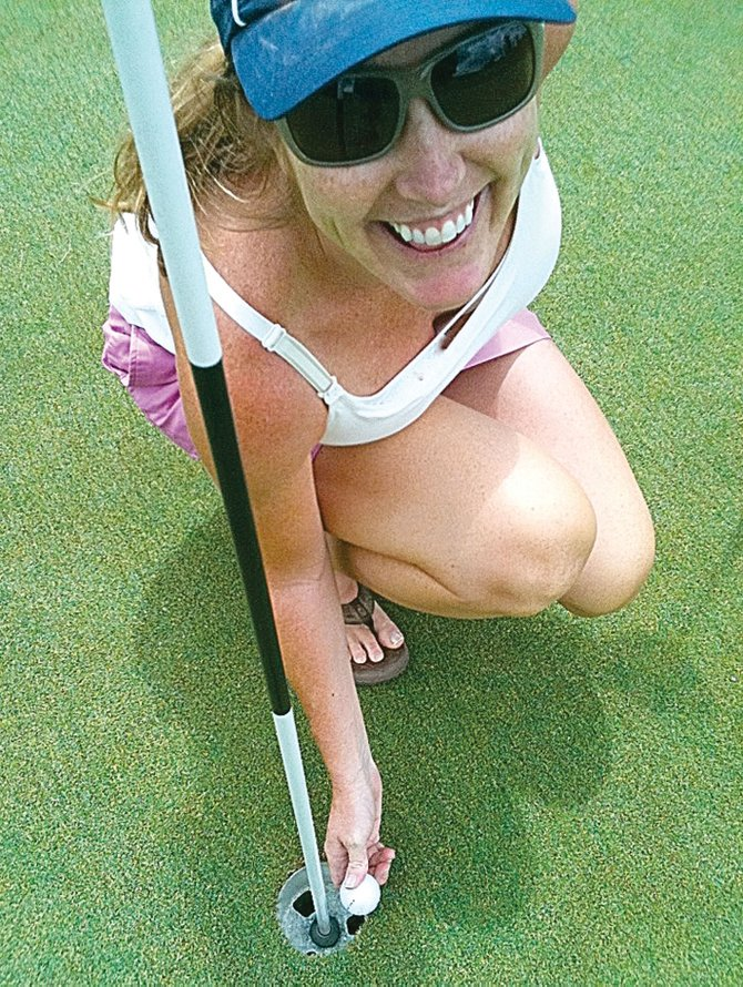 Laura Sehnert celebrates a hole-in-one on the No. 3 hole at the Steamboat Golf Club.
