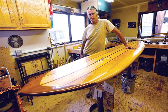 Steamboat Springs resident Paul Hobson builds his Estrus surfboards in a shop located behind his downtown Steam­boat home. Hobson uses balsa and redwood to create the custom boards.