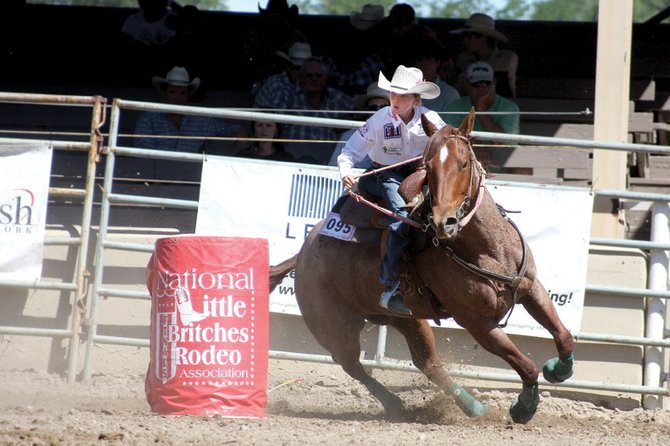 Kinlie Brennise, 10, competes in barrel racing June 30 during the 2011 National Little Britches Rodeo Finals in Pueblo. Kinlie and her horse, Peppi, recorded three solid times to take home the Junior Girl's Barrel Racing World Title.