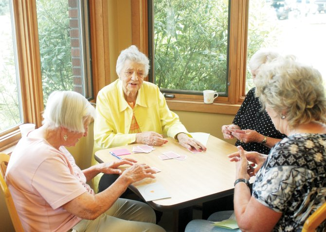 Lyle Koehler, center, celebrates her 90th birthday with fellow card sharks in the Mesa Club on Wednesday at the Rabbit Ears Motel. Her table included Jean Davidson, 96, at left. Koehler and her husband, Ron, purchased the motel in 1970 and her family continues to run it.