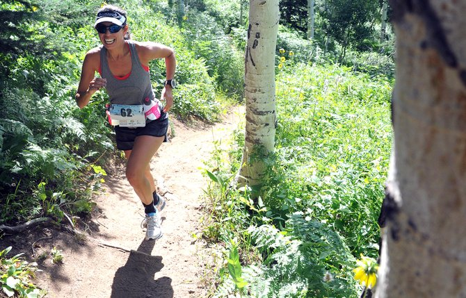 Joanne Schell runs up the steep slopes of Steamboat Ski Area on Saturday in the Mount Werner Classic in Steamboat Springs. The race attracted about 125 runners to two events, a 12-mile run and a 5-mile run.
