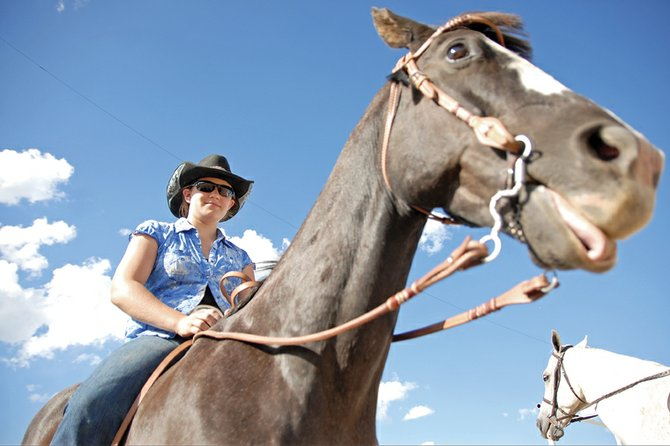 Craig resident Summer Ossen sits Friday atop her horse Widow Maker at the Moffat County Fairgrounds during the English Division of the 93rd annual Moffat County Fair's Open Horse Show. The Western division show takes place at 8 a.m. today.